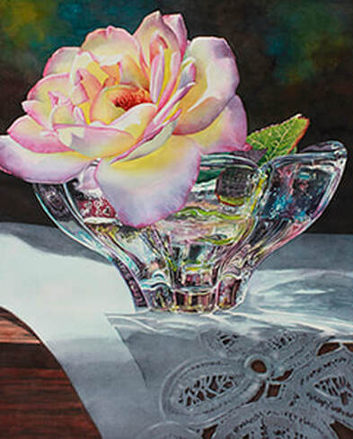 Rose in glass bowl